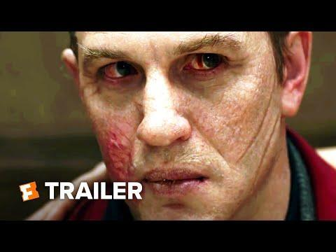 """<p>Tom Hardy's gift for hulking intensity and charismatic growling are in full effect in <em>Capone</em>, <a href=""""https://www.esquire.com/entertainment/movies/a32439185/al-capone-dementia-syphilis-treasure-true-story/"""" rel=""""nofollow noopener"""" target=""""_blank"""" data-ylk=""""slk:a fictionalized account of the last year in the life of the legendary American gangster"""" class=""""link rapid-noclick-resp"""">a fictionalized account of the last year in the life of the legendary American gangster</a>. Trapped in a palatial Florida estate, his mind deteriorating thanks to neurosyphilitic dementia, Al Capone (Hardy) rants, raves, soils himself and freaks out over hallucinatory visions of people, and events, from his past. <a href=""""https://www.esquire.com/entertainment/movies/a32438213/al-capone-tom-hardy-transformation-director-josh-trank-interview/"""" rel=""""nofollow noopener"""" target=""""_blank"""" data-ylk=""""slk:Writer/director Josh Trank's film is a subjective affair"""" class=""""link rapid-noclick-resp"""">Writer/director Josh Trank's film is a subjective affair</a> told largely from Capone's POV, so that nothing can be trusted and yet everything speaks, symbolically, to the man's deep-seated ambitions, fears and misgivings. It's a headfirst dive into delusion, told with free-flowing suspense and absurd comedy, all of which comes to the fore during a late scene in which Capone opens fire on his friends and family with a giant golden tommy gun while wearing a diaper and chomping on a cigar-like carrot. Part Cowardly Lion, part Bugs Bunny, and altogether ferocious even as his sanity frays, Hardy's Capone is yet another triumph for the star, who ultimately captures his protagonist less through imposing physicality than via his dark, glassy, lost eyes.</p><p><a class=""""link rapid-noclick-resp"""" href=""""https://www.amazon.com/Capone-Matt-Dillon/dp/B088BLDZHV/?tag=syn-yahoo-20&ascsubtag=%5Bartid%7C10054.g.29500577%5Bsrc%7Cyahoo-us"""" rel=""""nofollow noopener"""" target=""""_blank"""" data-ylk=""""slk:Watch Now"""">Watch Now</a></"""