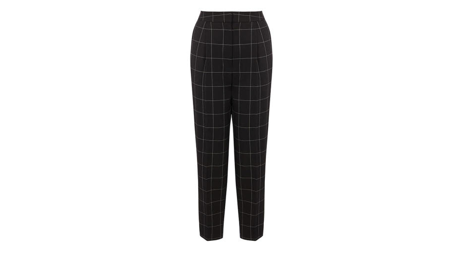 """<p>A good pair of peg trousers will keep you looking chic all year round. Team these with a chunky knit now and swap in a tee when summer arrives. <a rel=""""nofollow noopener"""" href=""""http://www.warehouse.co.uk/gb/just-arrived/all/windowpane-peg-trouser/031196.html?cgid=new-in-all&position=80&dwvar_031196_color=99#sz=60&start=80&categoryID=new-in-all"""" target=""""_blank"""" data-ylk=""""slk:Buy here."""" class=""""link rapid-noclick-resp""""><em>Buy here.</em></a> </p>"""