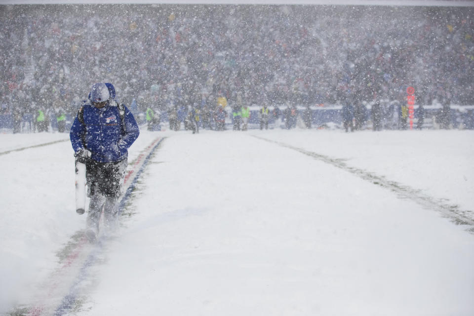 ORCHARD PARK, NY - DECEMBER 10:  Stadium workers use Stihl equipment to remove snow from the yard lines on the field during the game between the Buffalo Bills and the Indianapolis Colts at New Era Field on December 10, 2017 in Orchard Park, New York.  Buffalo defeats Indianapolis in overtime 13-7. (Photo by Brett Carlsen/Getty Images) *** Local Caption ***