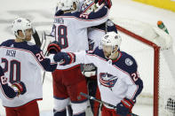 Columbus Blue Jackets center Riley Nash (20) congratulates right wing Oliver Bjorkstrand (28) in front of center Boone Jenner (38) who embraces goaltender Matiss Kivlenieks (80) after an NHL hockey game, Sunday, Jan. 19, 2020, in New York. Bjorkstrand had both goals as the Blue Jackets defeated the Rangers 2-1. (AP Photo/Kathy Willens)