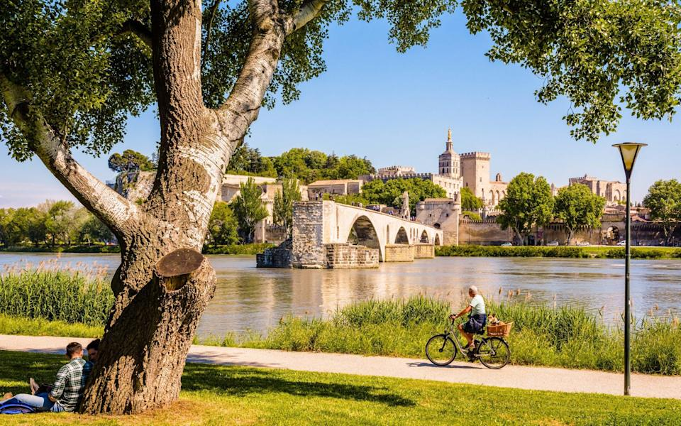 Cyclist on the banks of the Rhone - Getty