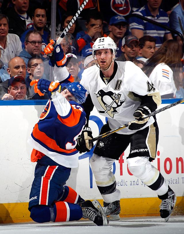 UNIONDALE, NY - MAY 11: Brooks Orpik #44 of the Pittsburgh Penguins knocks Casey Cizikas #53 of the New York Islanders to the ice on a check in the second period in Game Six of the Eastern Conference Quarterfinals during the 2013 NHL Stanley Cup Playoffs at Nassau Veterans Memorial Coliseum on May 11, 2013 in Uniondale, New York. (Photo by Paul Bereswill/Getty Images)