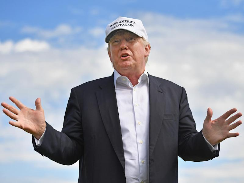 Donald Trump was pictured on the golf course at a Trump-branded hotel in Virginia where the White House said he would be in meetings: Getty Images