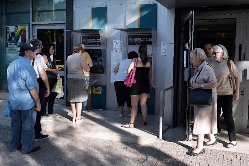 Cash withdrawals were limited to 60 euros ($65) per day after Greeks emptied ATMs, worried for the safety of their savings (AFP Photo/Louisa Gouliamaki)