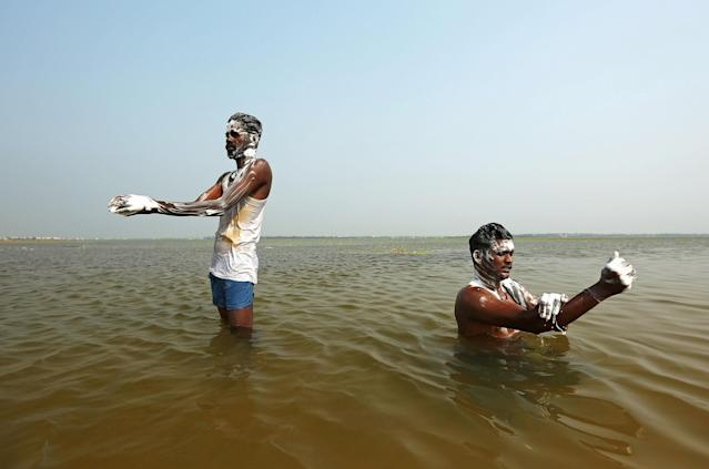 Men bathe in the waters of Puzhal lake on the occasion of World Water Day, in Chennai, India, March 22, 2018. REUTERS/P.Ravikumar TPX IMAGES OF THE DAY