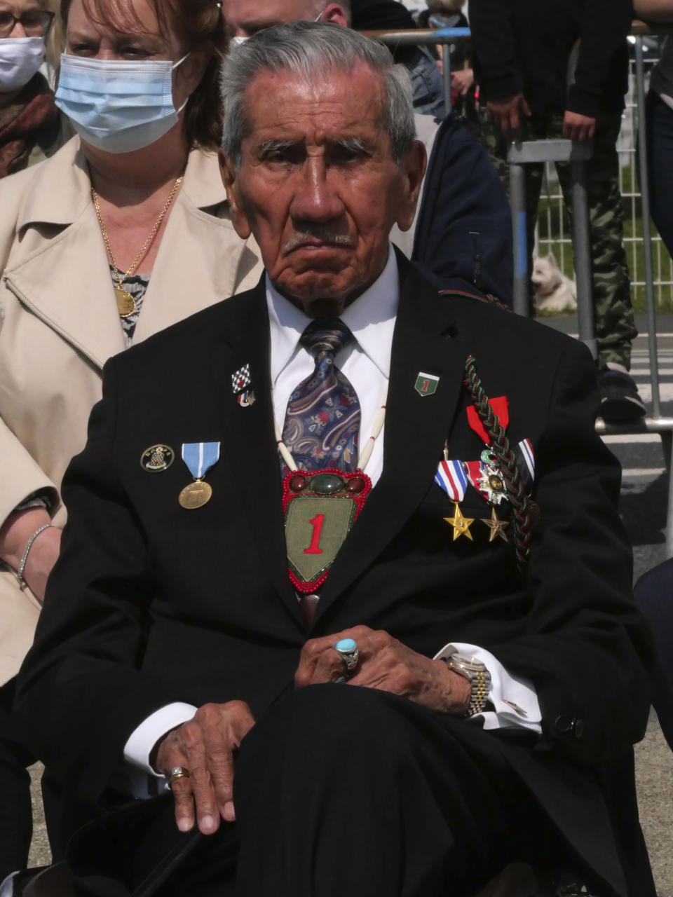 Charles Shay, right, the 96-year-old native American from Indian Island, Maine, attends a D-Day ceremony in Carentan, Normandy, Friday, June 4, 2021. In a small Normandy town where paratroopers landed in the early hours of D-Day, applauds broke the silence to honor Charles Shay. He was the only veteran to attend the ceremony in Carentan commemorating the 77th anniversary of the assault that led to the end World War II. Shay was a 19-year-old U.S. Army medic when he landed on Omaha Beach. (AP Photo/Nicolas Garriga)