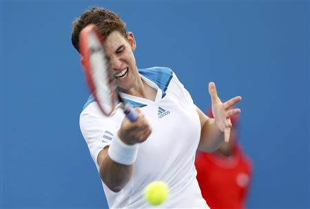 Dominic Thiem of Austria hits a return to Kevin Anderson of South Africa during their men's singles match at the Australian Open 2014 tennis tournament in Melbourne January 15, 2014. REUTERS/Brandon Malone