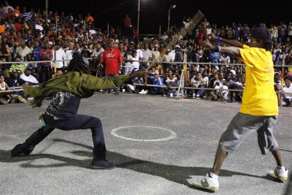"Local stick fighters square off against each other in an arena known as the ""gayelle"" in the village of Mayaro, eastern Trinidad, February 9, 2012."