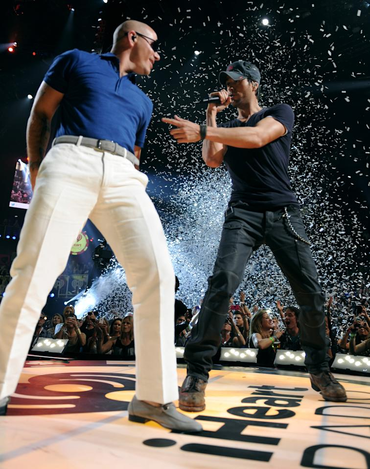 Rapper Pitbull (L) and singer Enrique Iglesias perform onstage during the 2012 iHeartRadio Music Festival at the MGM Grand Garden Arena on September 22, 2012 in Las Vegas, Nevada.  (Photo by Denise Truscello/WireImage)