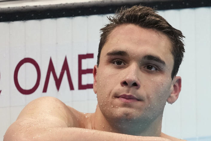 Kristof Milak of Hungary rests after winning the men's 200-meter butterfly final at the 2020 Summer Olympics, Wednesday, July 28, 2021, in Tokyo, Japan. (AP Photo/Matthias Schrader)