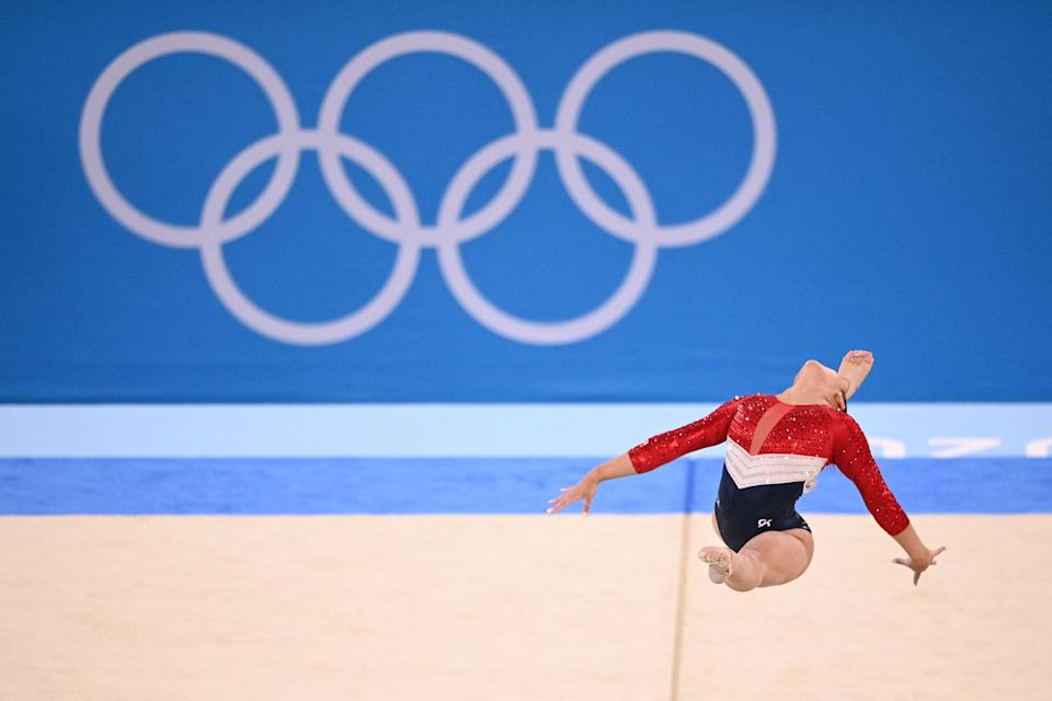USA's Sunisa Lee competes during the floor event of the artistic gymnastics women's team final during the Tokyo 2020 Olympic Games at the Ariake Gymnastics Centre in Tokyo on July 27, 2021. (Photo by Martin BUREAU / AFP) (Photo by MARTIN BUREAU/AFP via Getty Images)