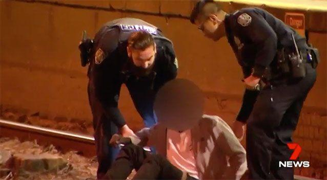 Two officers were required to remove one of the youths. Photo: 7 News