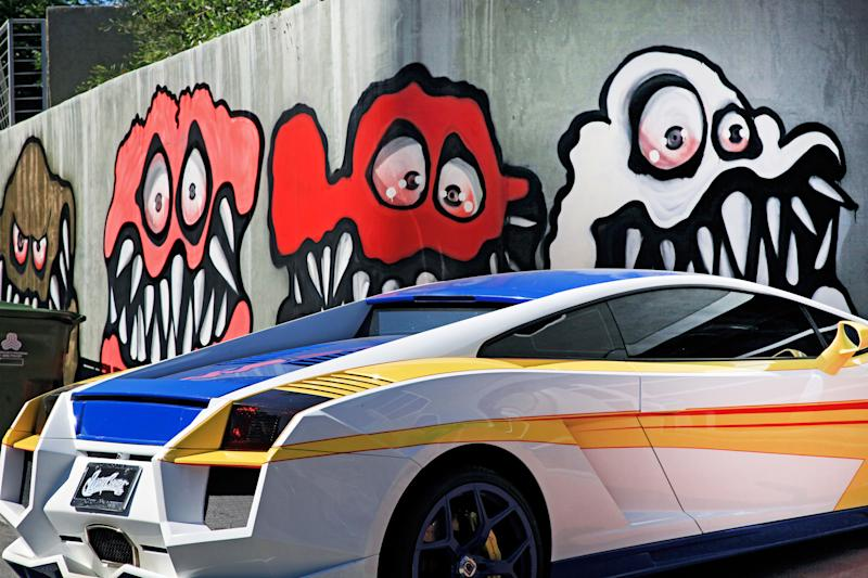This Sunday May 12, 2013 photo shows a mural painted on the outside of musician Chris Brown's home in Los Angeles. The Grammy-winning musician's neighbors are unhappy with what some are calling frightening art he's chosen to have painted along the curb of his Hollywood Hills home. (AP Photo/Richard Vogel)