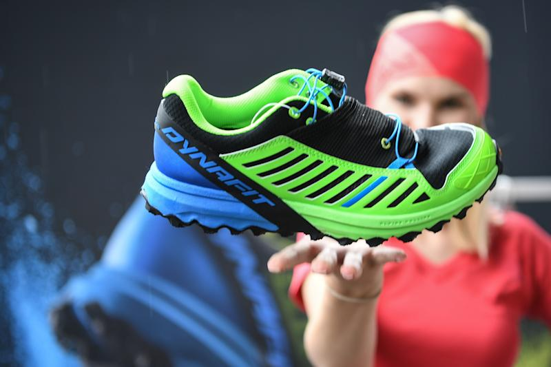Model Jette throwing the trail running shoe Alpine Pro of manufacturer Dynafit one day before the start of the Outdoor fair in Friedrichshafen, Germany, 12 July 2016. The shoe weighs less than 300 gramm. PHOTO: FELIX KAESTLE/dpa | usage worldwide (Photo by Felix Kästle/picture alliance via Getty Images)