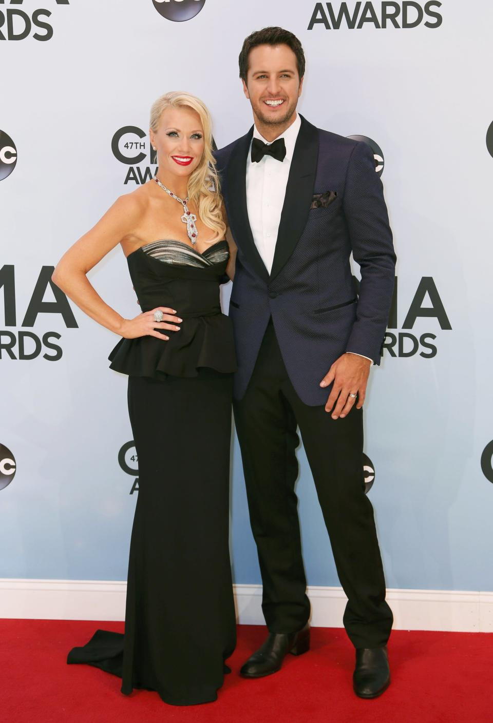 Luke Bryan and his wife Caroline Boyer pose on arrival at the 47th Country Music Association Awards in Nashville, Tennessee November 6, 2013. REUTERS/Eric Henderson (UNITED STATES - Tags: ENTERTAINMENT)