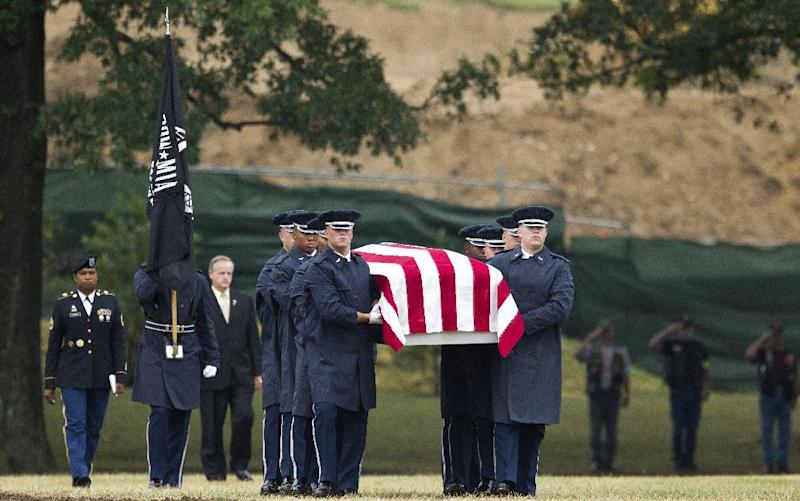 """An Air Force carry team carries the casket with the remains of Air Force Col. Joseph Christiano, Col. Derrell B. Jeffords, Lt. Col. Dennis L. Eilers, Chieft Master Sgt. William K. Colwell, Chief Master Sgt. Arden K. Hassenger and Chief Master Sgt. Larry C. Thornton, during a burial service at Arlington National Cemetery Arlington, Va., Monday, July 9, 2012. It was Christmas Eve 1965 when the Air Force plane nicknamed """"Spooky"""" took off from Vietnam for a combat mission. The crew sent out a """"mayday"""" signal while flying over Laos, and after that, all contact was lost. Two days of searches turned up nothing. (AP Photo/Haraz N. Ghanbari)"""