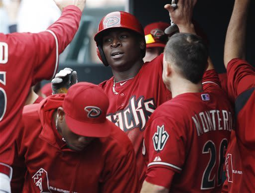 Arizona Diamondbacks' Didi Gregorius, center, is congratulated after hitting a solo home run to lead off the fifth inning against the Colorado Rockies in a baseball game in Denver on Sunday, April 21, 2013. (AP Photo/David Zalubowski)