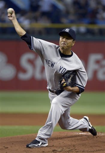 New York Yankees starting pitcher Hiroki Kuroda, of Japan, throws to home plate during the first inning of a baseball game against the Tampa Bay Rays in St. Petersburg, Fla., Saturday, April 7, 2012.(AP Photo/Phelan M. Ebenhack)
