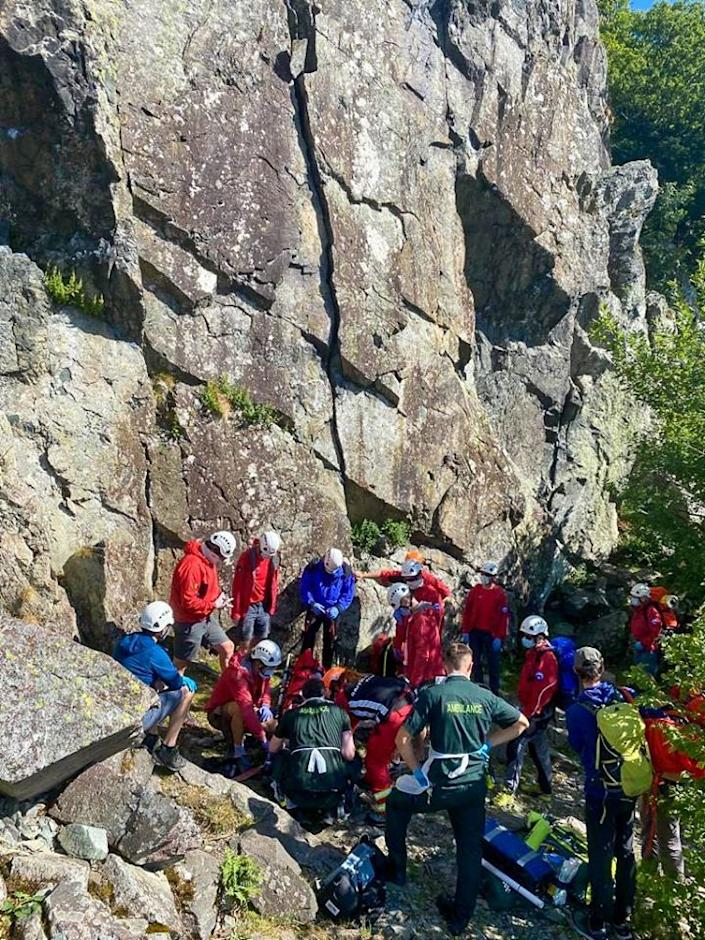 Mountain rescuers and ambulance staff attend to a climber after he fell 26ft from a cliff face (Keswick Mountain Rescue Team)