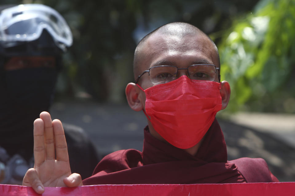 A monk displays a three-finger symbol of resistance during a protest against the military coup in Mandalay, Myanmar, Friday, March 12, 2021. Myanmar's security forces shot to death at least 10 people protesting the military's coup, spurning a U.N. Security Council appeal to stop using lethal force. (AP Photo)
