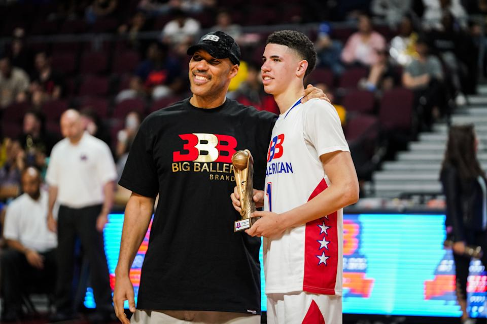 LAS VEGAS, NEVADA - MARCH 31: LaVar Ball presents an award to son LaMelo Ball after the Big Baller Brand All American Game at the Orleans Arena on March 31, 2019 in Las Vegas, Nevada. (Photo by Cassy Athena/Getty Images)