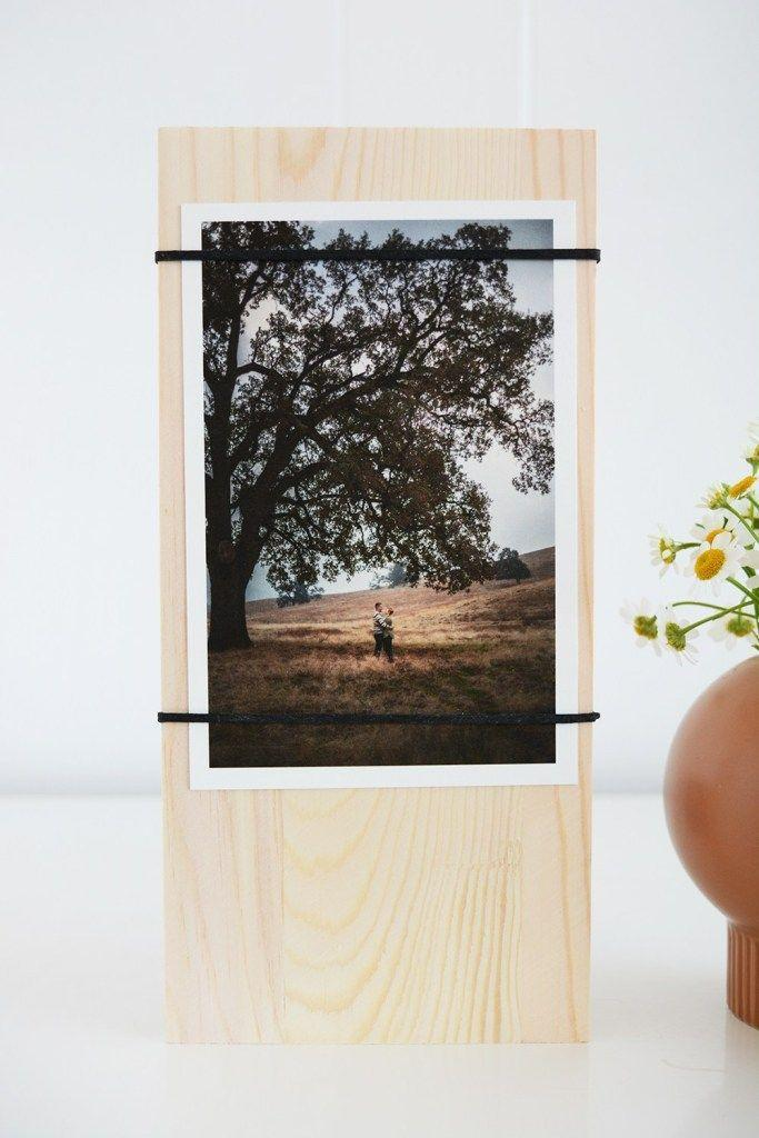 """<p>Beat out your siblings for favorite child by adding a sentimental photo of you and your dad together. </p><p><a href=""""http://oleanderandpalm.com/2018/06/diy-photo-display.html"""" rel=""""nofollow noopener"""" target=""""_blank"""" data-ylk=""""slk:Get the tutorial."""" class=""""link rapid-noclick-resp"""">Get the tutorial.</a></p>"""