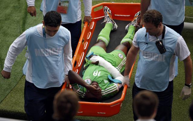 Nigeria's Michael Babatunde is carried off after getting injured during their 2014 World Cup Group F soccer match against Argentina at the Beira Rio stadium in Porto Alegre June 25, 2014. REUTERS/Marko Djurica (BRAZIL - Tags: SOCCER SPORT WORLD CUP)