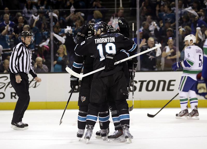 The San Jose Sharks celebrate a goal from Joe Pavelski during the first period of Game 3 of their first-round NHL hockey Stanley Cup playoff series against the Vancouver Canucks in San Jose, Calif., Sunday, May 5, 2013. (AP Photo/Marcio Jose Sanchez)