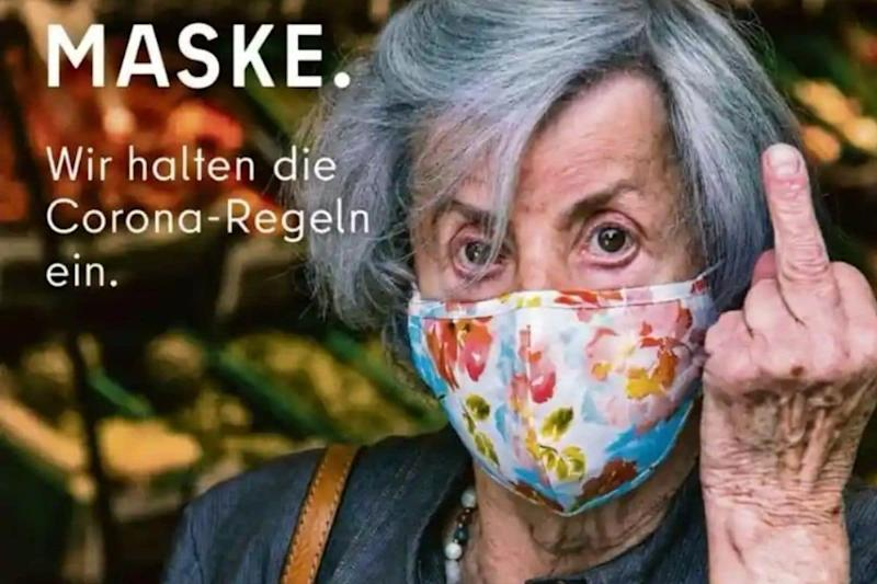 Berlin's 'Provocative' Ad Pulled Down for Raising Middle Finger to Everyone without a Mask