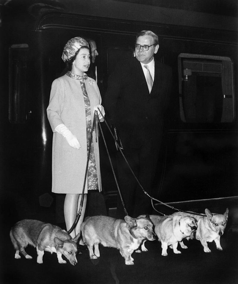 Queen Elizabeth II arrives at King's Cross railway station in London with her corgis after holidays in Balmoral Castle in Scotland and before welcoming the astronauts of Apollo 11 who walked on the moon to Buckingham Palace, 1969.