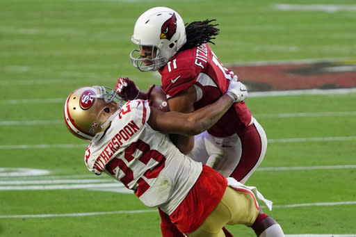 Arizona Cardinals wide receiver Larry Fitzgerald (11) makes a catch as San Francisco 49ers cornerback Ahkello Witherspoon (23) defends during the second half of an NFL football game, Saturday, Dec. 26, 2020, in Glendale, Ariz. (AP Photo/Rick Scuteri)