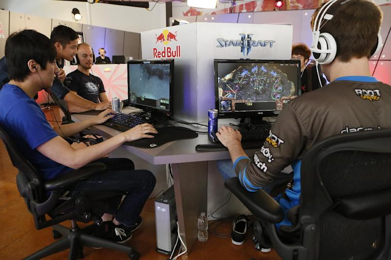 "In this photo taken Friday, June 21, 2013, legendary ""WarCraft 3"" player, Jo ""Golden"" Myeong Hwan, from South Korea, left, joins seven of the world's best ""StarCraft II"" video game players to train at Red Bull Training Grounds, held at Red Bull North America headquarters in Santa Monica, Calif. The Red Bull TV e-sports series included live-streamed scrimmages and a tournament with $8,600 in prize money. (AP Photo/Damian Dovarganes)"