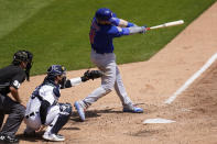 Chicago Cubs' Ian Happ hits a solo home run against the Detroit Tigers in the sixth inning of a baseball game in Detroit, Sunday, May 16, 2021. (AP Photo/Paul Sancya)