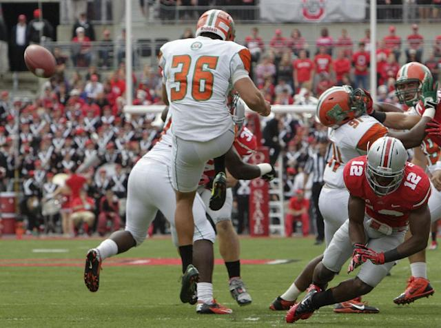 Ohio State cornerback Doran Grant, right, blocks the punt of Florida A&M punter Colby Blanton during the first quarter of an NCAA college football game Saturday, Sept. 21, 2013, in Columbus, Ohio. (AP Photo/Jay LaPrete)