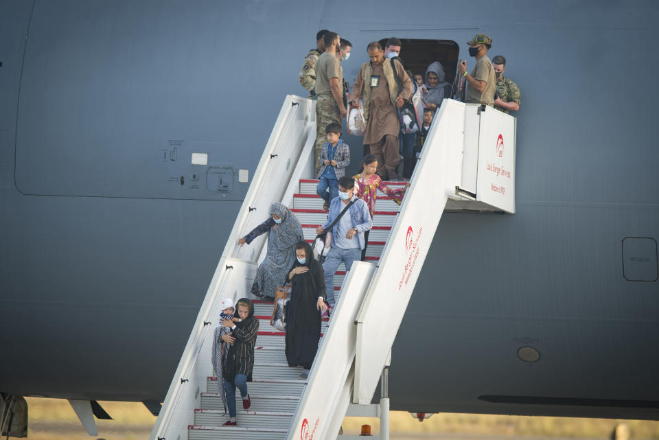 Evacuees from Afghanistan disembark from a U.S. airforce plane at the Naval Station in Rota, southern Spain, Tuesday Aug. 31, 2021. The United States completed its withdrawal from Afghanistan late Monday, ending America's longest war. (AP Photo/ Marcos Moreno)