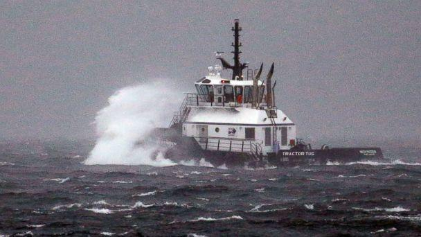 PHOTO: The tugboat, Rich Padden, is battered by waves as it heads out to relocate to a new port on Puget Sound in a windstorm, Nov. 13, 2017, in Seattle. (Elaine Thompson/AP)