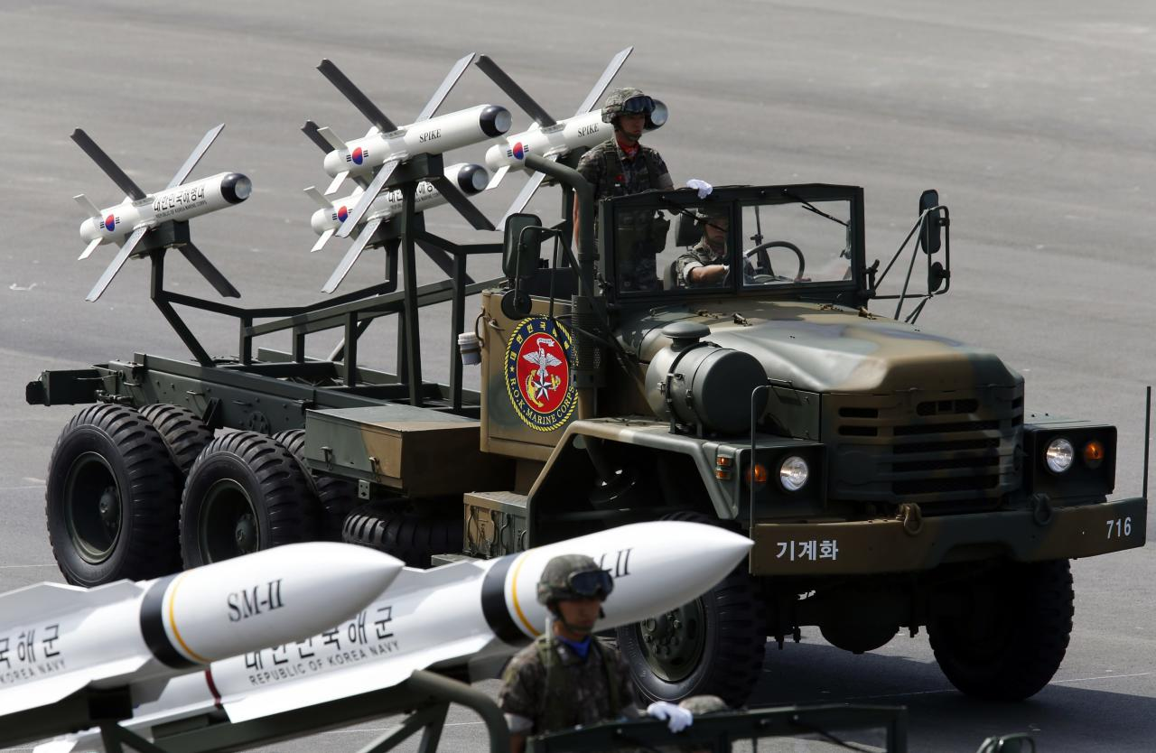 South Korea's Israeli-made Spike missiles (rear) are seen during events to mark the 65th anniversary of Armed Forces Day, at a military airport in Seongnam, south of Seoul, October 1, 2013. The 500 kilometre-range Hyunmoo 2 , 1,000 kilometre-range Hyunmoo 3, and the Spike missiles were unveiled to the public today, according to local media. REUTERS/Kim Hong-Ji (SOUTH KOREA - Tags: MILITARY ANNIVERSARY)