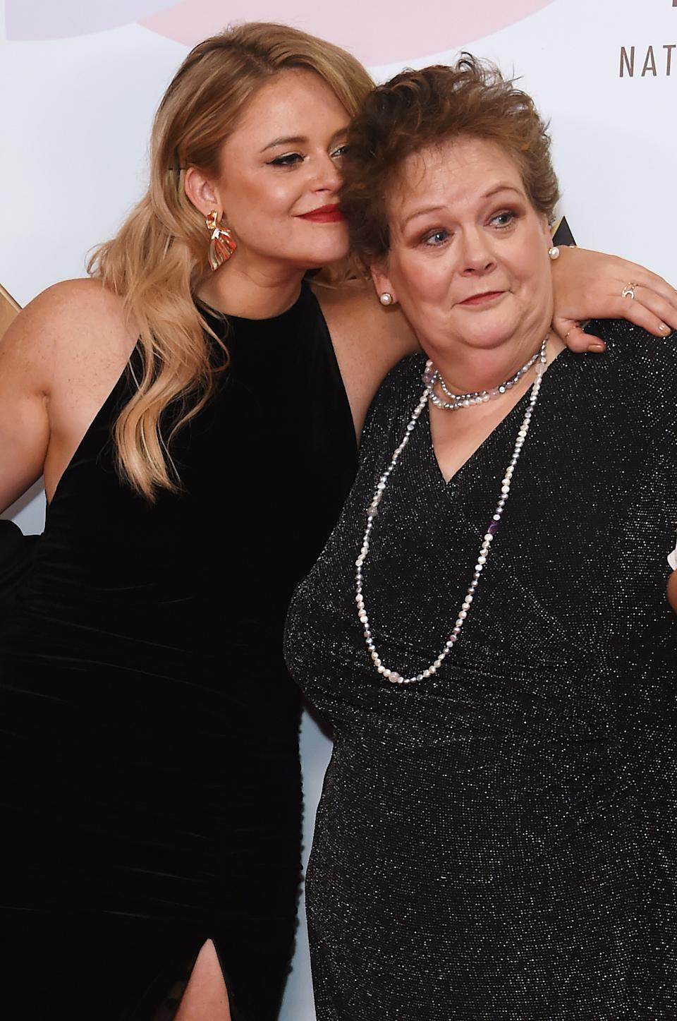 LONDON, ENGLAND - JANUARY 22:  Emily Atack (L) and Anne Hegerty, accepting the Bruce Forsyth Award for Entertainment for 'I'm A Celebrity...Get Me Out Of Here!', pose in the Winners Room during the National Television Awards held at The O2 Arena on January 22, 2019 in London, England.  (Photo by David M. Benett/Dave Benett/Getty Images)