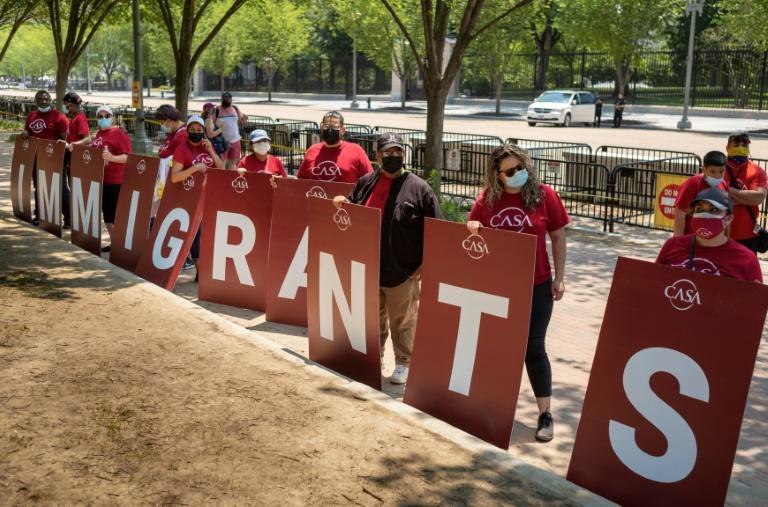 Immigration rights activists take part in a rally to demand action on citizenship at Lafayette Square, across from the White House in Washington, DC on May 26, 2021