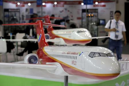 FILE PHOTO: Models of the ARJ21 regional jet from Commercial Aircraft Corp of China (COMAC) are displayed at the Aviation Expo China 2015 in Beijing, China, September 16, 2015.   REUTERS/Jason Lee/File Photo