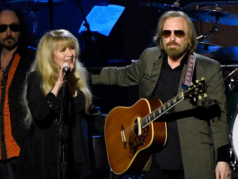 Stevie Nicks, left, and honoree Tom Petty perform at the MusiCares Person of the Year tribute at the Los Angeles Convention Center on Friday, Feb. 10, 2017.