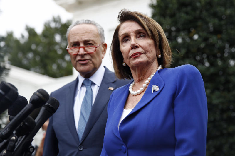 House Speaker Nancy Pelosi of Calif., alongside Senate Minority Leader Sen. Chuck Schumer of N.Y., outside of the West Wing of the White House on Wednesday, Oct. 16, 2019. (AP Photo/Patrick Semansky)