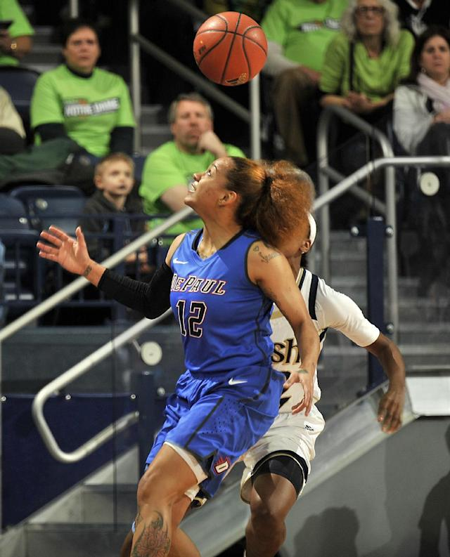 DePaul guard Brittany Hrynko grabs a pass during the first half of an NCAA college basketball game against Notre Dame, Tuesday, Nov. 26, 2013, in South Bend, Ind. (AP Photo/Joe Raymond)