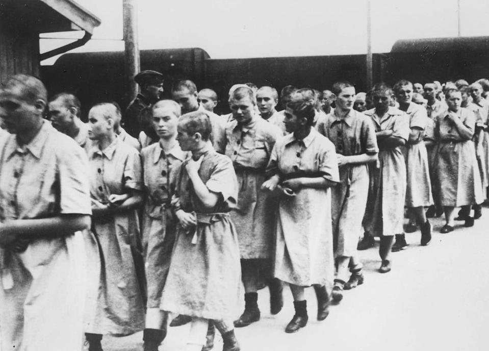 """<div class=""""inline-image__caption""""><p>A photo of women deemed fit for work, taken in May 1944 in the Auschwitz-Birkenau extermination camp, in Oswiecim, after the camp absorption process.</p></div> <div class=""""inline-image__credit"""">AFP via Getty </div>"""