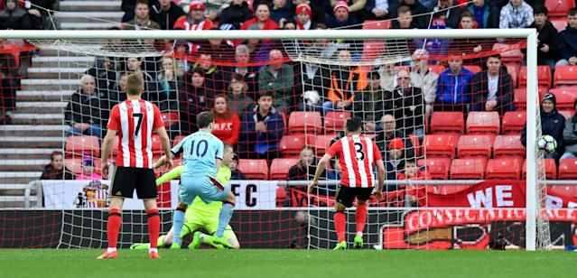 <p>Sunderland's Jordan Pickford and Burnley's Ashley Barnes look on as the ball goes wide </p>