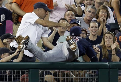 CORRECTS TO THIRD BASEMAN, INSTEAD OF SHORTSTOP - Cleveland Indians third baseman Jason Donald catches a foul ball by Detroit Tigers' Brennan Boesch during the fourth inning of a baseball game in Detroit, Wednesday, Sept. 5, 2012. (AP Photo/Paul Sancya)