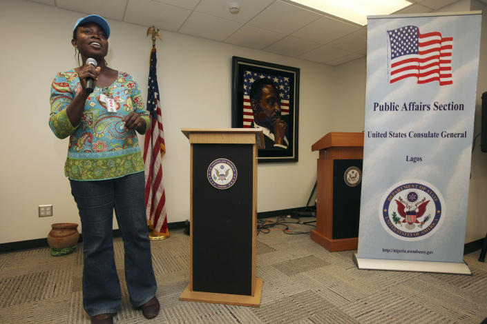 FILE - In this, Friday, Dec. 2, 2011 photo, Abosede Oladayo, 36, an AIDS activist living with HIV, speaks during an event to mark World Aids Day at the U.S Embassy in Lagos, Nigeria. Local and international groups fighting AIDS warned on Tuesday, Jan. 14, 2014, that a new Nigerian law criminalizing same-sex marriage and gay organizations will jeopardize the fight against the deadly disease. The United States, Britain and Canada condemned the law, with Secretary of State John Kerry saying Monday that it 'dangerously restricts freedom' of expression and association of all Nigerians.(AP Photo/Sunday Alamba, File)