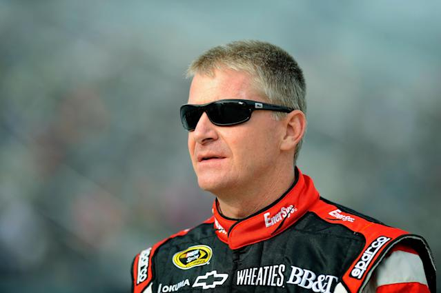 RIDGEWAY, VA - OCTOBER 26: Jeff Burton, driver of the #31 Odyssey/EnerSys Chevrolet, stands on the grid during qualifying for the NASCAR Sprint Cup Series Tums Fast Relief 500 at Martinsville Speedway on October 26, 2012 in Ridgeway, Virginia. (Photo by Jared C. Tilton/Getty Images for NASCAR)