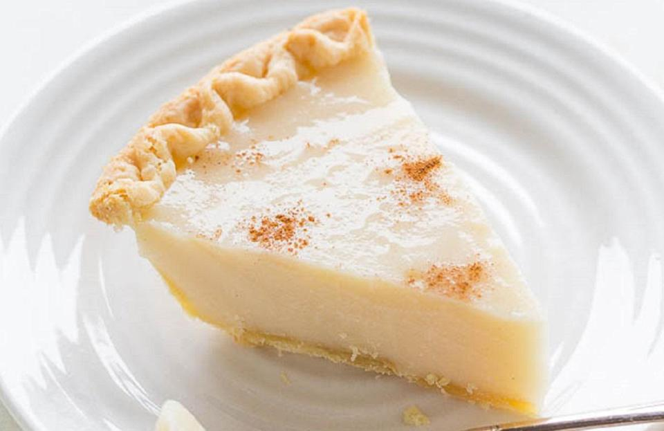 """<p>One of the best dishes you can make from pantry staples, the sugar cream pie is made with milk, sugar, cornstarch, vanilla and butter. One of <a href=""""https://www.thedailymeal.com/most-iconic-pie-every-state-gallery?referrer=yahoo&category=beauty_food&include_utm=1&utm_medium=referral&utm_source=yahoo&utm_campaign=feed"""" rel=""""nofollow noopener"""" target=""""_blank"""" data-ylk=""""slk:the most-loved pies in America"""" class=""""link rapid-noclick-resp"""">the most-loved pies in America</a>, this sugar cream pie is so beloved in its home state of Indiana, it's also called Hoosier Pie.</p> <p><a href=""""https://www.thedailymeal.com/best-recipes/sugar-cream-pie?referrer=yahoo&category=beauty_food&include_utm=1&utm_medium=referral&utm_source=yahoo&utm_campaign=feed"""" rel=""""nofollow noopener"""" target=""""_blank"""" data-ylk=""""slk:For the Easy Sugar Cream Pie recipe, click here."""" class=""""link rapid-noclick-resp"""">For the Easy Sugar Cream Pie recipe, click here.</a></p>"""