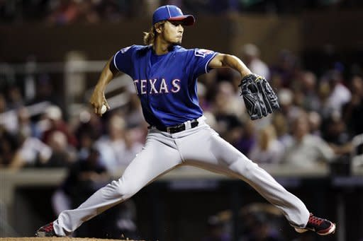 Texas Rangers starting pitcher Yu Darvish throws to the Colorado Rockies during the second inning of a spring training baseball game, Friday, March 30, 2012, in Scottsdale, Ariz. (AP Photo/Marcio Jose Sanchez)